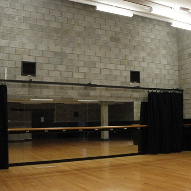 Flexible rehearsal studio space with wooden floors, mirrored walls, air-conditioning and WiFi access.